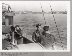 Amerikansk militær om bord på skib nær vejrstationen